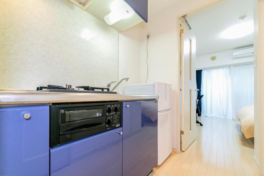 お部屋入口には仕切り扉が設置。室温管理にぜひご活用ください