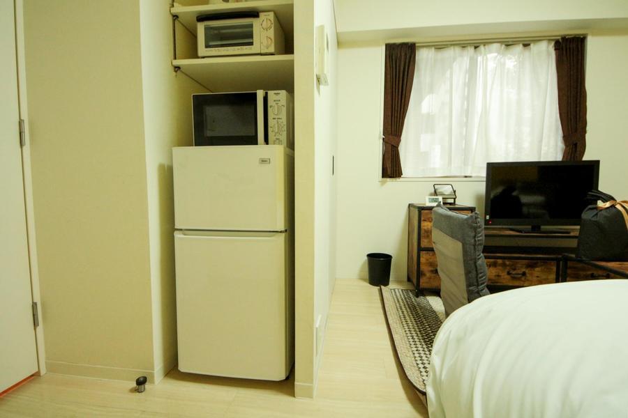冷蔵庫や電子レンジなどは専用エリアに収納し、見た目もスッキリ