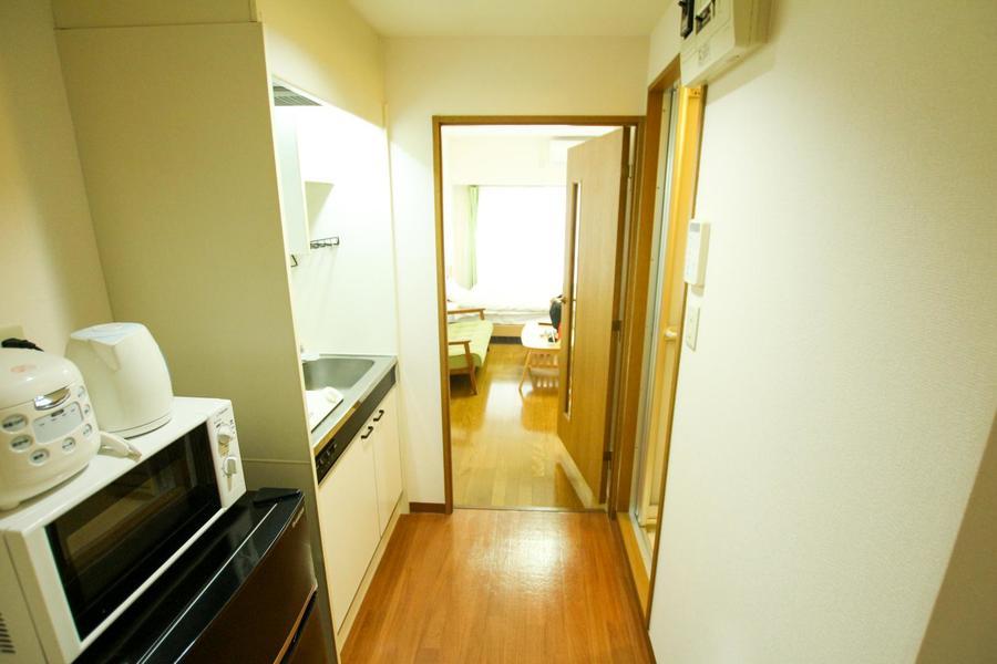 お部屋と廊下の間には仕切り扉を設置。来客時も安心です
