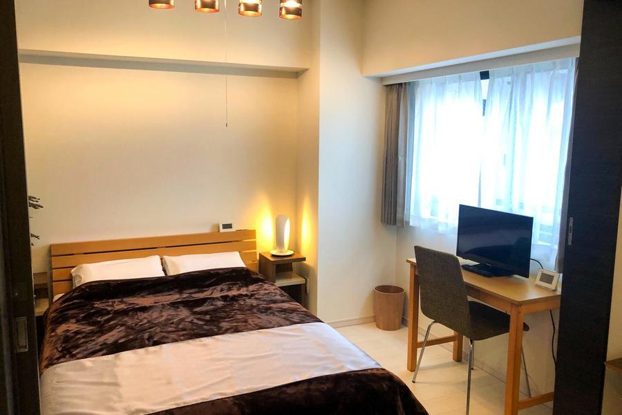 ベッドはダブルサイズを設置。外国籍のお客様からご好評いただいております