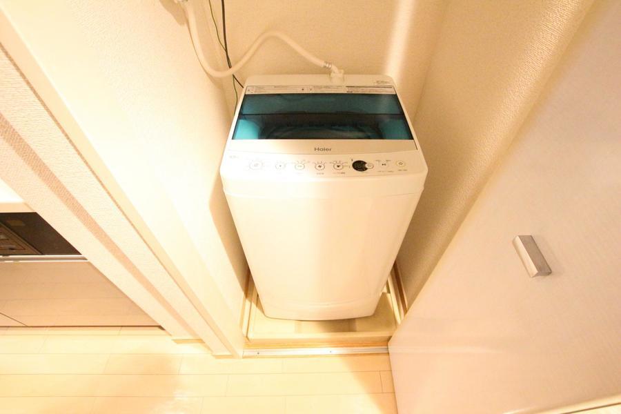 洗濯機置き場は扉付き。未使用時は目隠しが出来て見栄えもスッキリ!