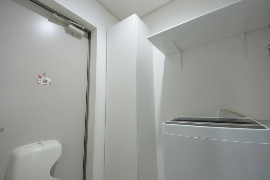 玄関と洗濯スペース。
