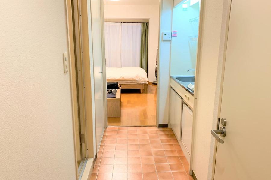 廊下床面はお部屋とは違いレンガ調デザイン
