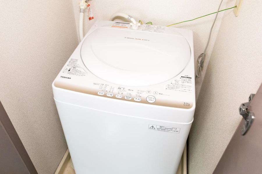 洗濯機はお部屋の中に設置。扉付きなので来客時も安心