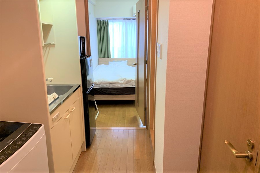 お部屋との間には仕切り扉を設置。来客時のプライバシー保護に役立ちます