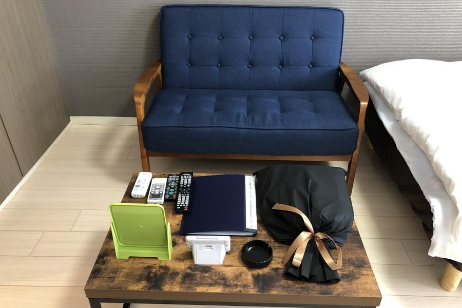 ゆったりくつろげるソファ。ローテーブルとともにシックにまとめました